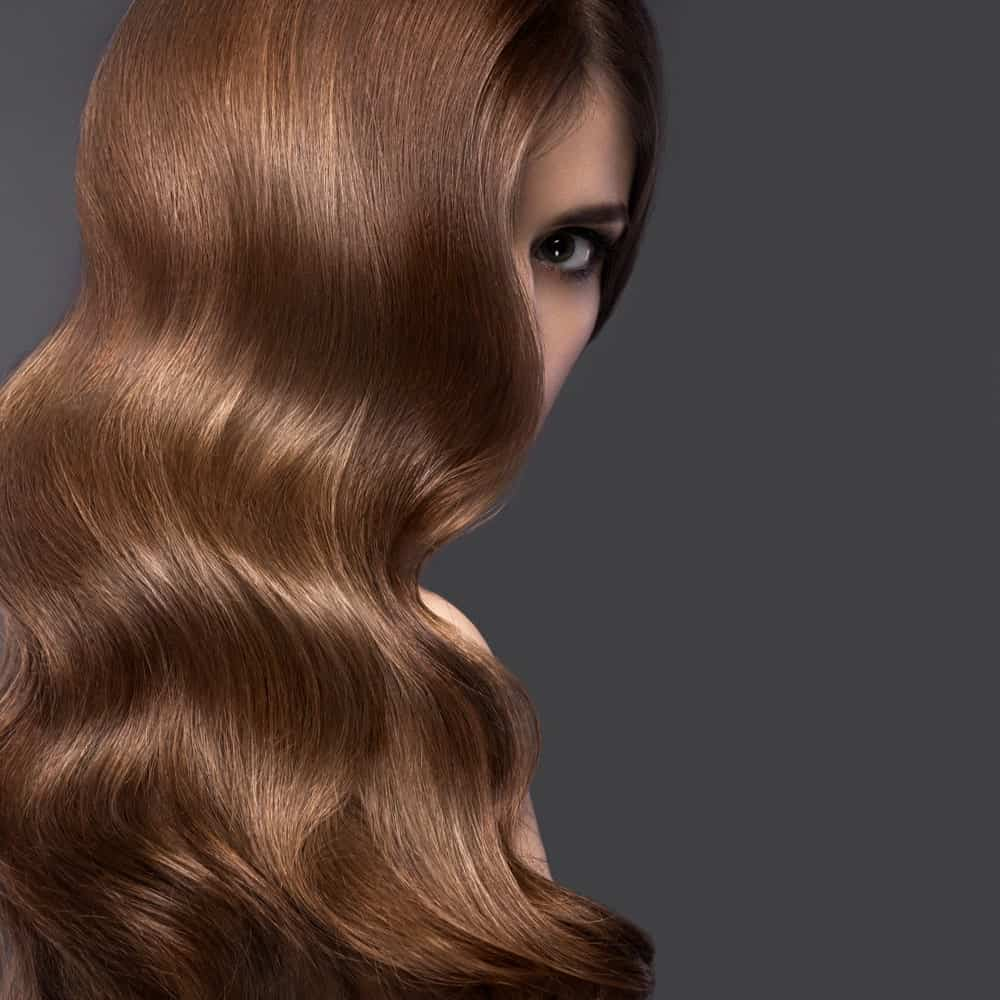 Woman with thick wavy brown hair.