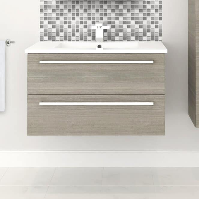 Wall-mounted vanity with an undermount sink against the gray mosaic tile backsplash.