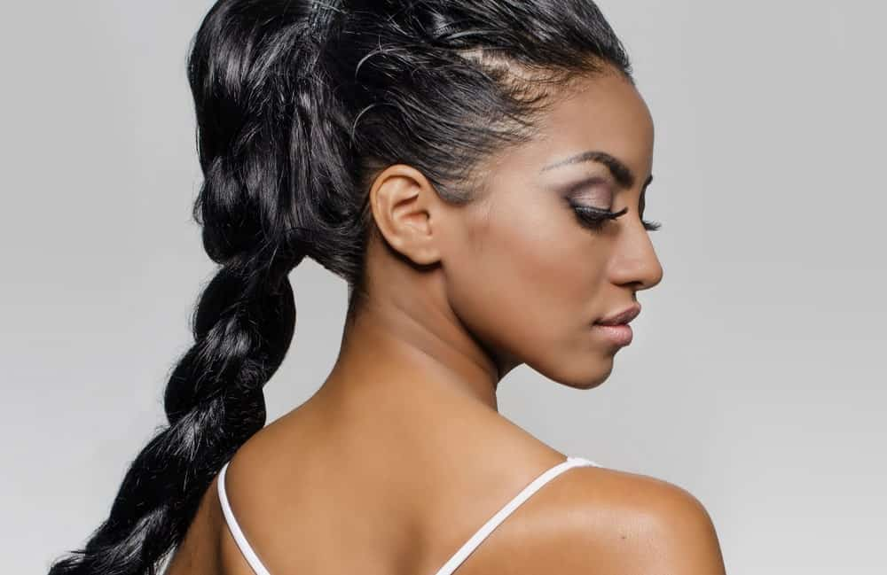 A woman with a single braid ponytail.