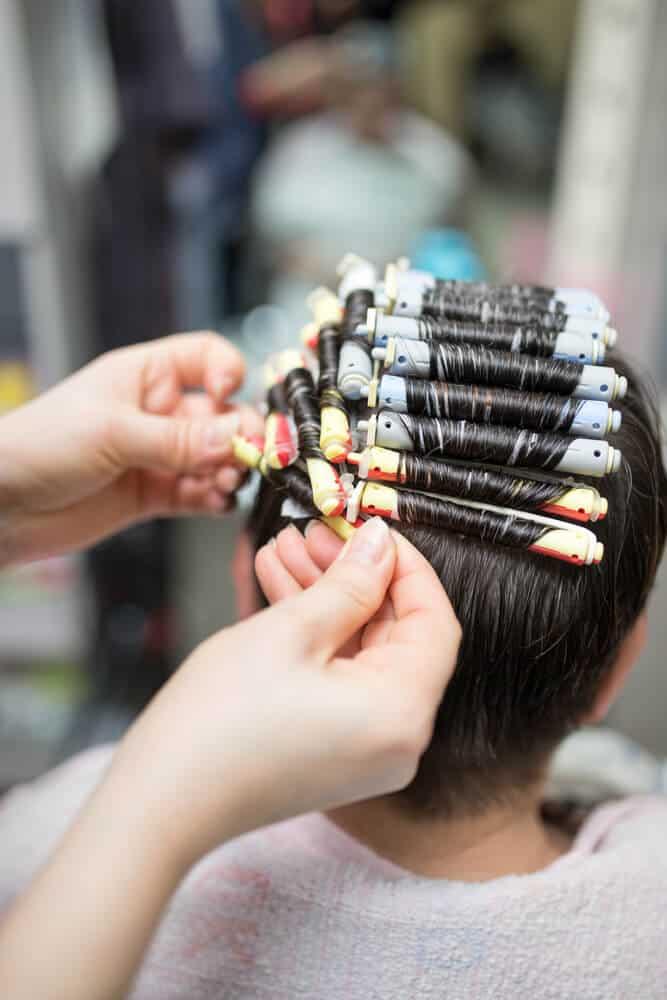 Perming done in a hair salon.