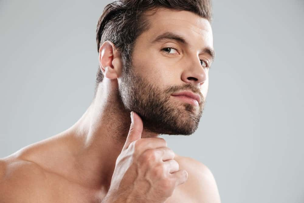Man examining his beard.