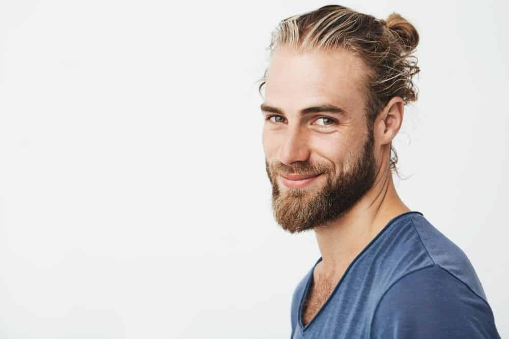 Man with a full beard and a man bun.