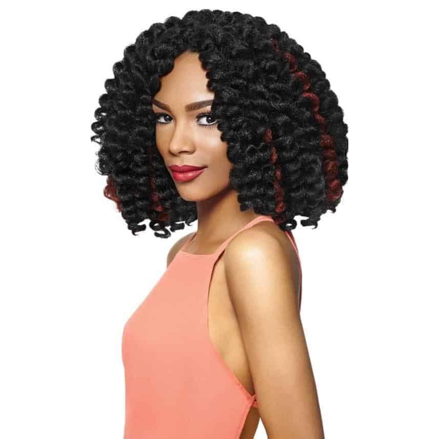 Woman with bouncy, multi-colored crochet hair.