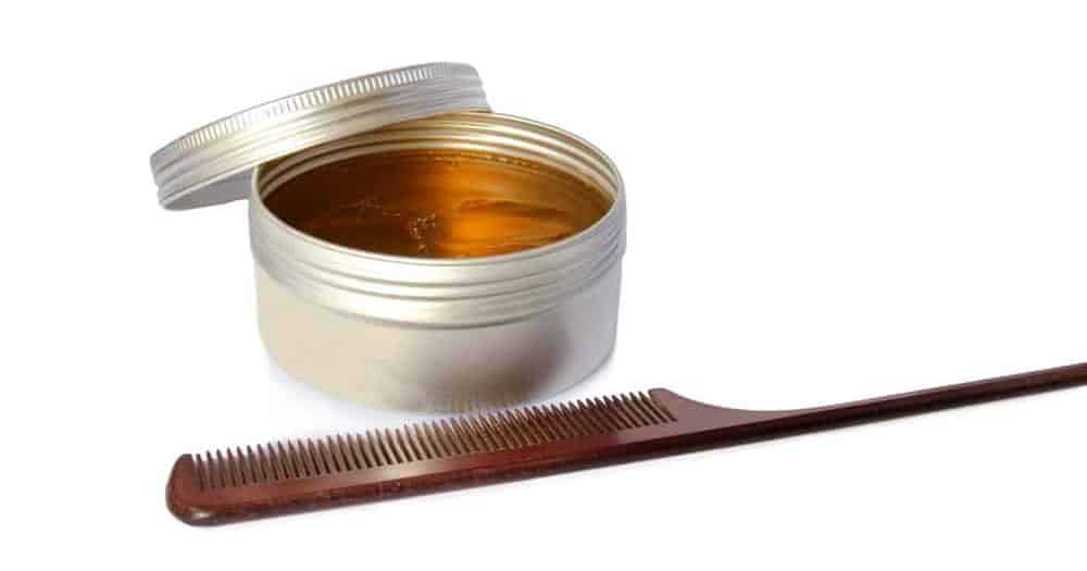 Hair pomade with a styling comb.