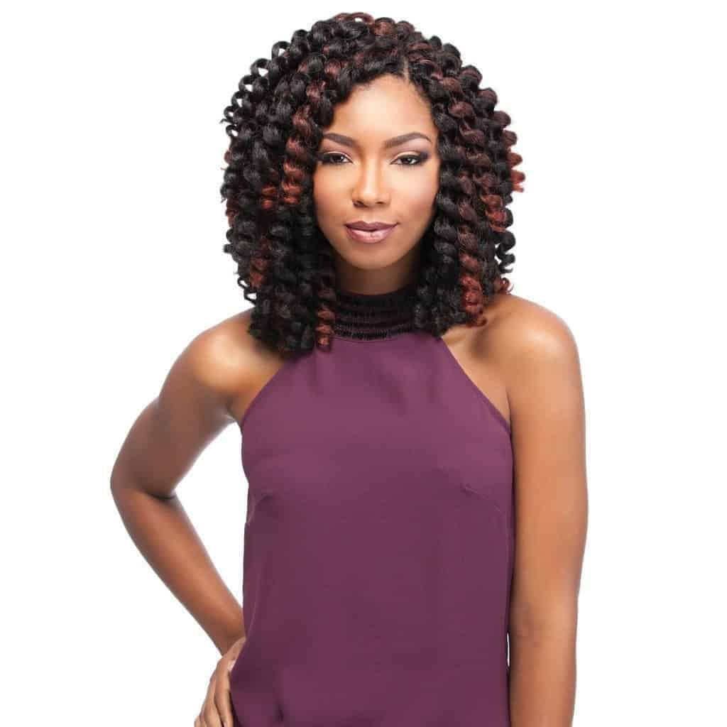 Woman with short, highlighted crochet hair.