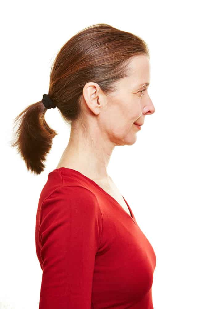 Side profile of an old woman with a ponytail.