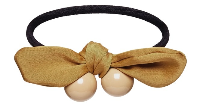 A close look at a ponytail barrette with a bow.