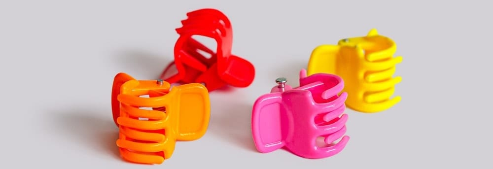 A look at a set of colorful plastic round clips.