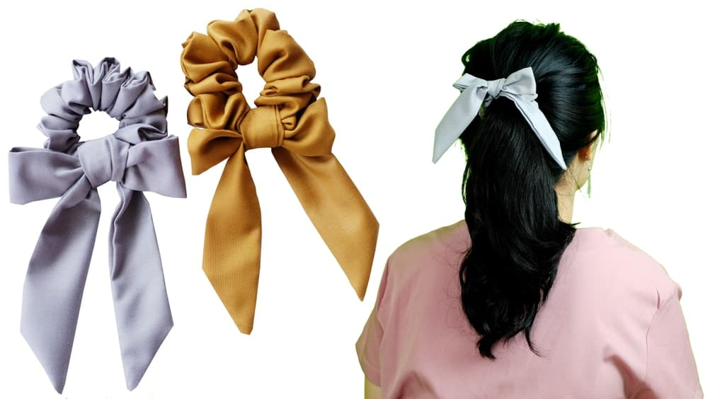 A woman wearing a bow hair tie.