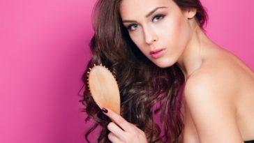 A woman brushing her wavy long hair.