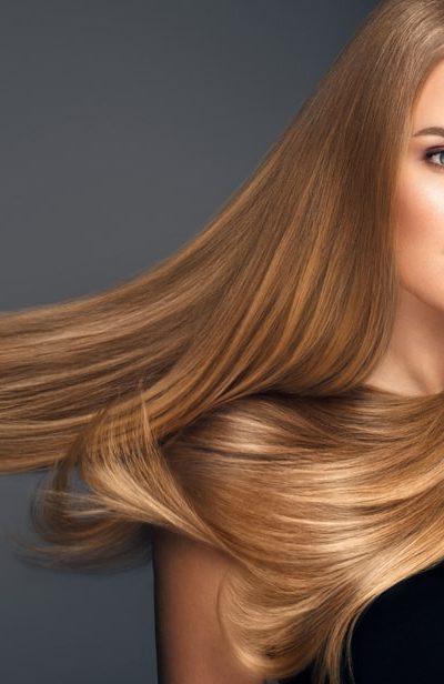 A woman sporting a long straight light brown hair.