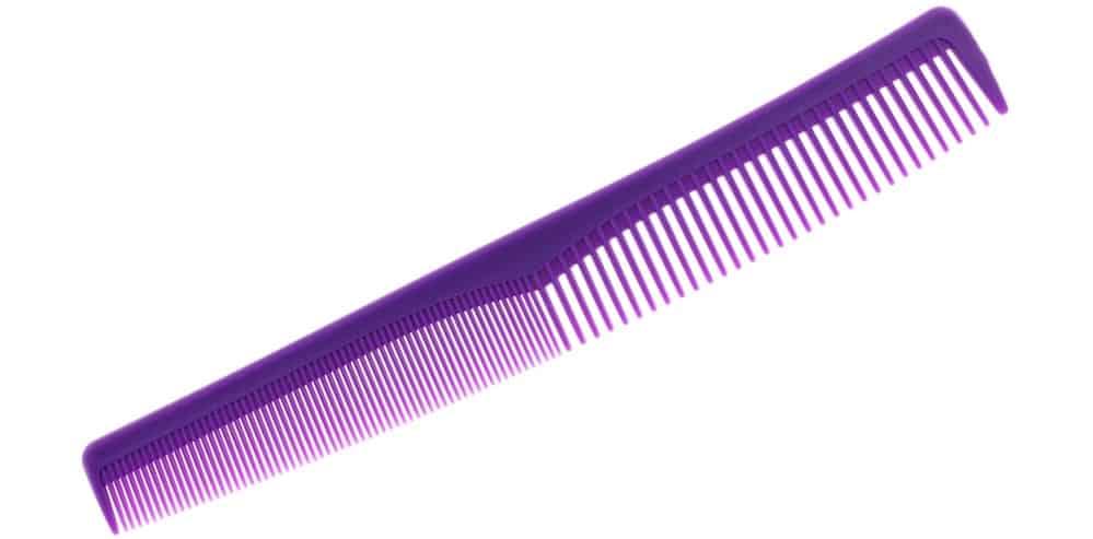 A purple plastic fine-tooth comb.