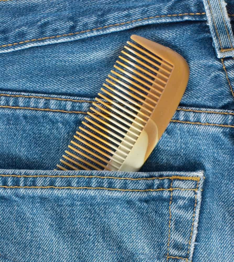 A look at a brown pocket comb in a jeans pocket.