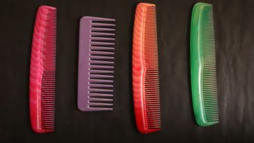 Various colorful plastic combs.