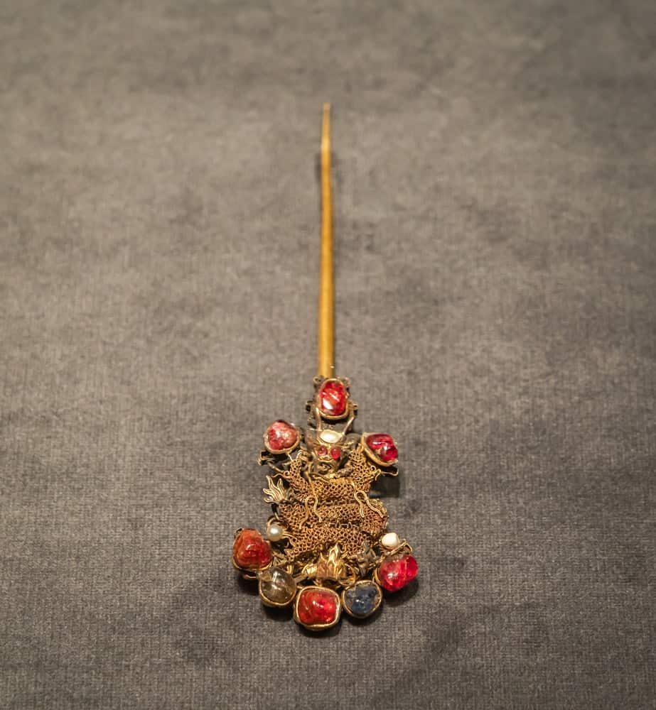 An ancient Chinese hair pin with a figure of an eastern dragon.