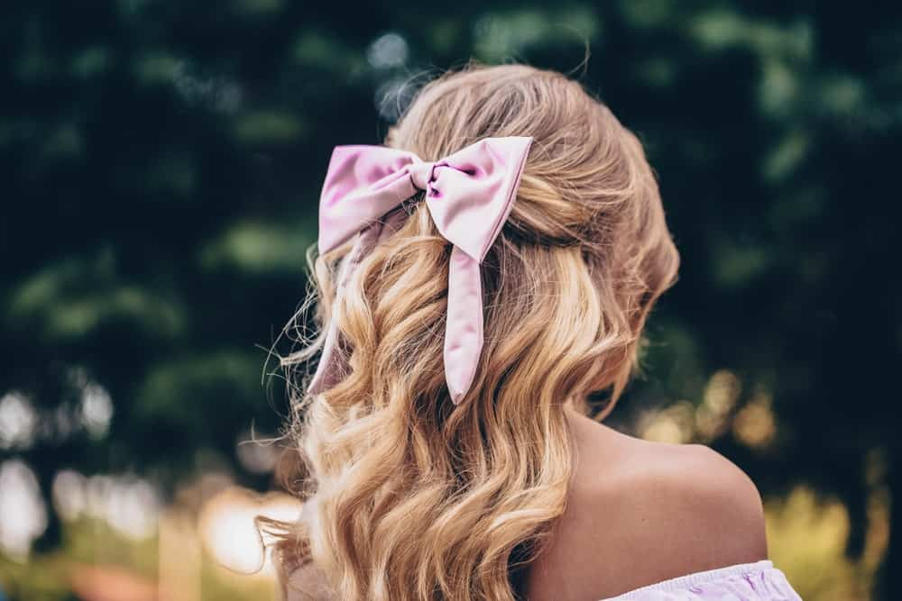 A woman wearing a ribbon bow on her hair.