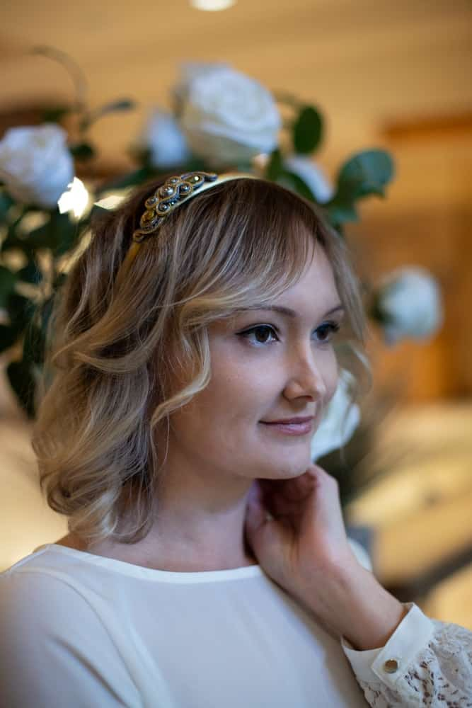 A woman wearing an ornate metal headband.
