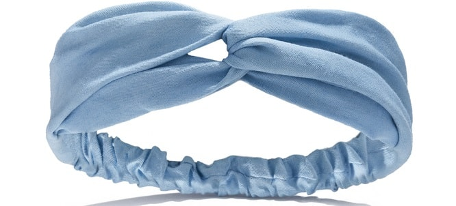 A close look at a blue fabric headband.