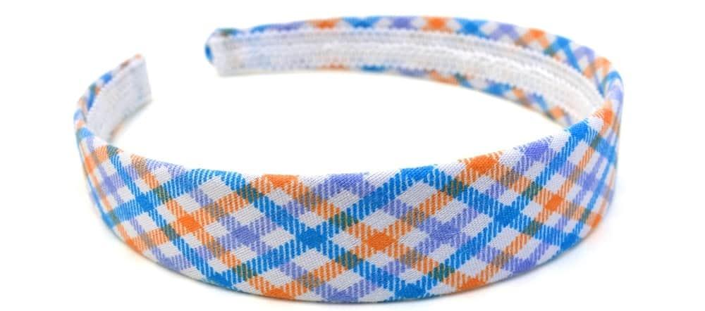 A close look at a checkered colorful horseshoe headband.