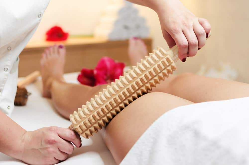 A close look at a woman having an anti-cellulite massage.