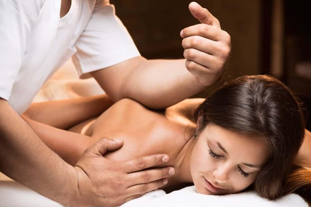 A woman enjoying her deep tissue massage.