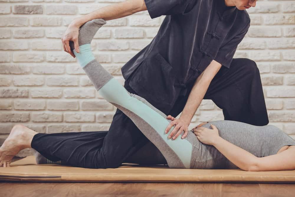 A pregnant woman having a Thai yoga massage.