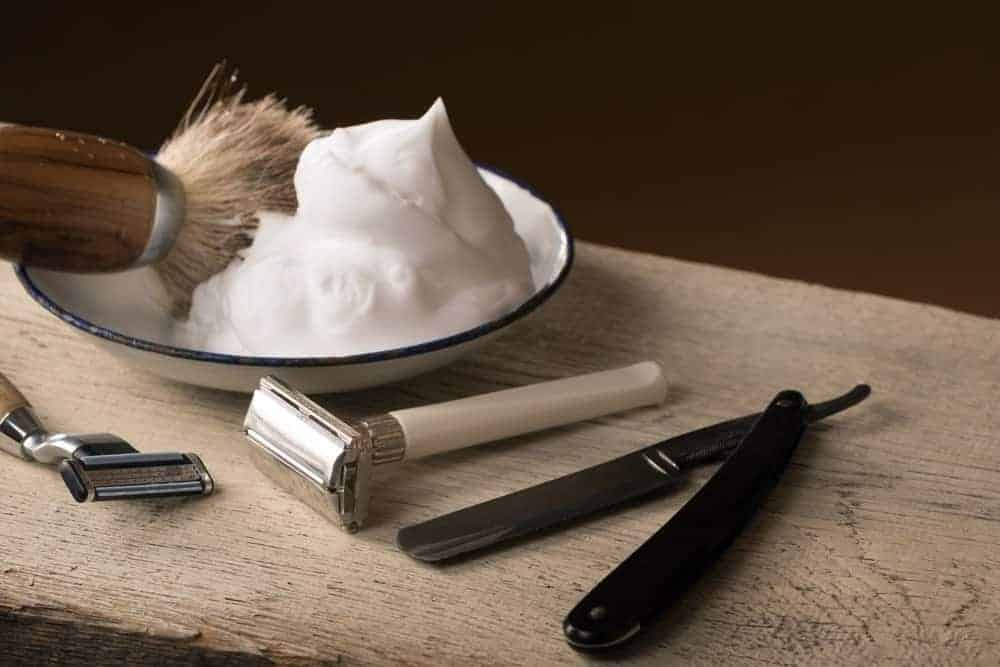Shaving blades along with combo, brush and shaving foam in a ceramic plate.