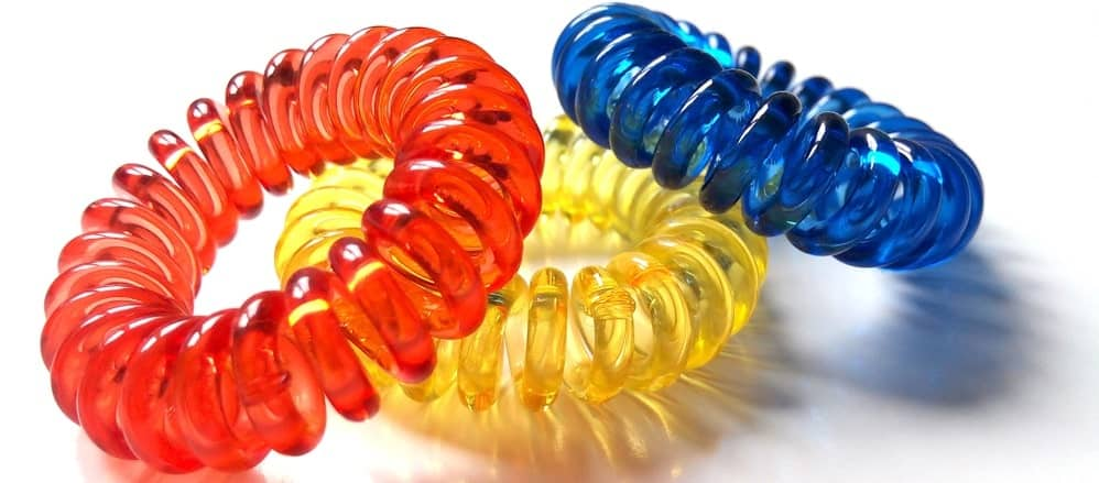 Three colorful spiral hair ties.