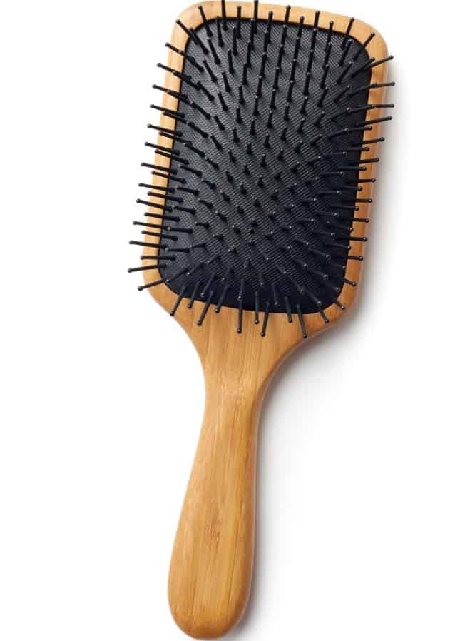 A bamboo paddle hair brush.