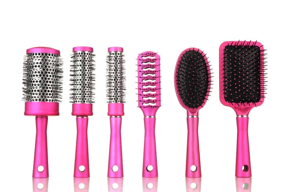 A row of various hair brushes.