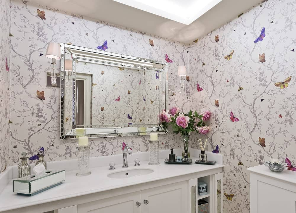 Bathroom with butterfly wallpaper.